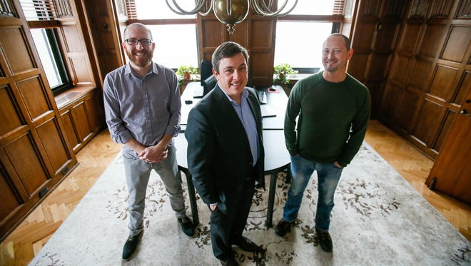 Managing Director Benjamin Cainin, from the left, Policy Counsel Ed Herman, and Managing Director Nigel Griswold, all of Dynamo Metrics get their photo taken in their office in the Penobscot building in Downtown Detroit on Wednesday, Jan. 13, 2016. Kimberly P. Mitchell/Detroit Free Press