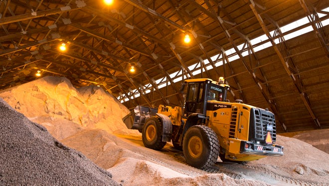 A truck places road salt into a pile inside a PennDOT salt storage building at the entrance to I-476, the Pennsylvania Turnpike Northeast Extension, in Pittston Twp., Pa., on Friday, Jan. 22, 2016. (Christopher Dolan/The Citizens' Voice via AP)