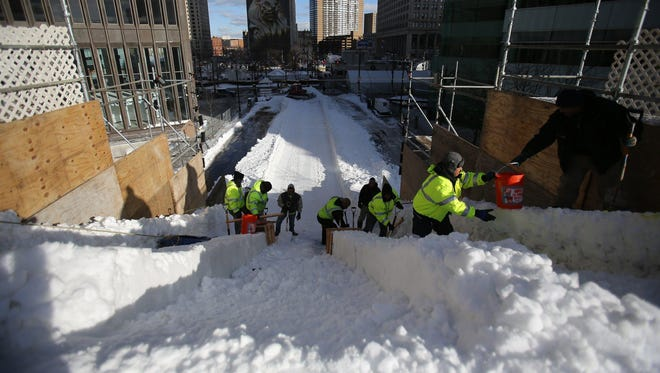 Workers prepare for the 2016 Meridian Winter Blast in Campus Martius Park in downtown Detroit on Thursday.