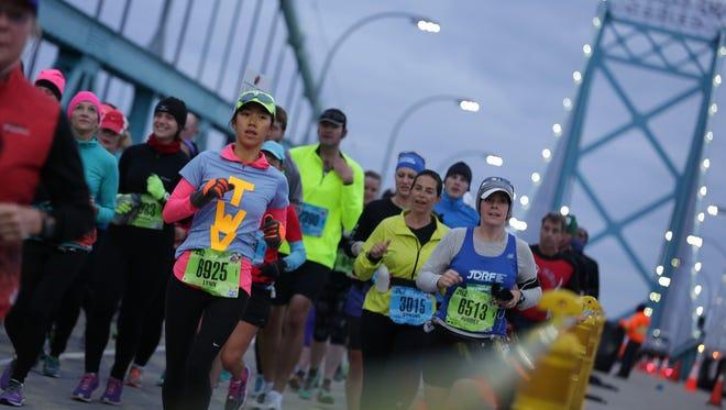 Runners cross the Ambassador Bridge toward Canada during the 38th snnual Detroit Free Press/Talmer Bank Marathon in Detroit on Oct. 18, 2015.