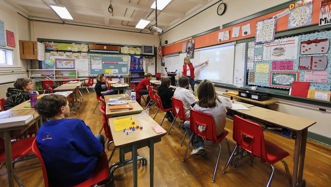 Roosevelt Elementary Principal Rhonda Zobrak teaches a sixth-grade algebra class in the school that was built in 1928.
