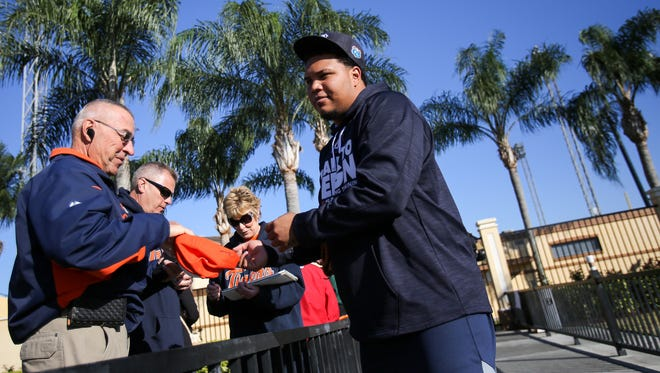 Detroit Tigers pitcher Bruce Rondon signs autographs during at Joker Marchant stadium in Lakeland, Fla., on Thursday, Feb. 18, 2016.