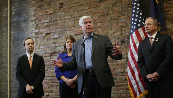 Governor Rick Snyder speaks to the press about the next steps identifying and replacing high-risk and high-priority pipes in Flint during a press conference at the Rowe Professional Services in Flint on Wednesday February 17, 2016.
