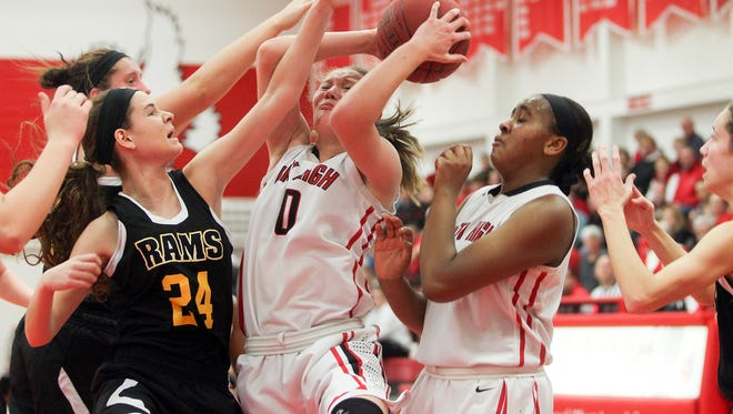 City High's Ashley Joens fights for a rebound during the Little Hawks' Class 5A Regional final against Southeast Polk on Tuesday, Feb. 23, 2016.