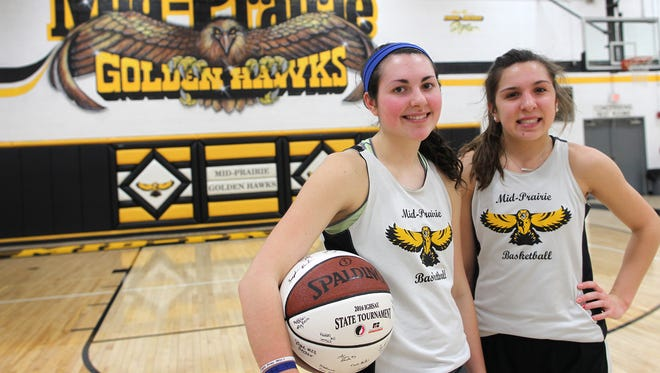 Mid-Prairie sisters Addie Rath, left, and Alex Rath pose for a photo at school on Friday, Feb. 26, 2016.