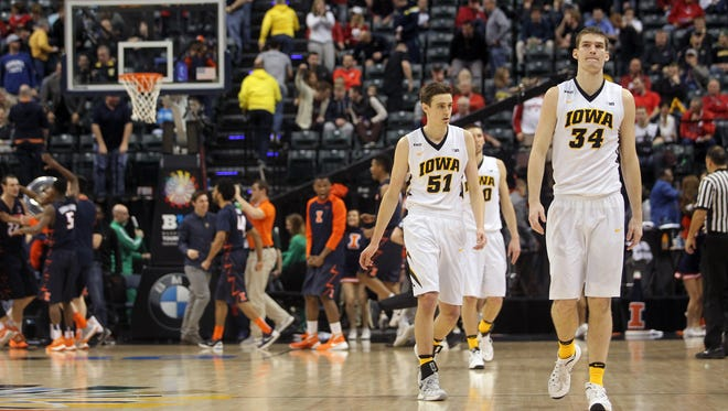 Iowa's Adam Woodbury, right, and Nicholas Baer head to the locker room following the Hawkeyes' 68-66 loss to Illinois at the Big Ten Men's Basketball Tournament at Bankers Life Fieldhouse in Indianapolis, Ind. on Thursday, March 10, 2016.