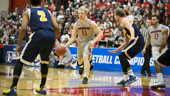 Western Oregon's Tanner Omlid (11) looks for an open teammate in a game against against UC San Diego in the third round of the NCAA Division II Tournament on Monday, March 14, 2016, in Monmouth, Ore. Western Oregon won the game 60-55.