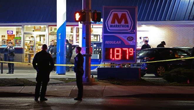 The scene of an officer-involved shooting at the Marathon gas station at the intersection of 10th Street and Rural Street, on the east side of Indianapolis, Ind., Tuesday, April 5, 2016. The suspect died.
