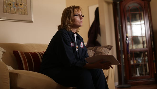 Lori Kelly, 53, of Vienna Township talks about her mother, 80-year-old Nelda Hunt, who died on July 22, 2015, at McLaren Hospital in Flint, on Monday, Feb. 22, 2016, at her home in Vienna Township.