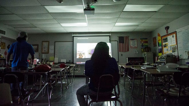Keily Perez of Guatemala mingles with her friends at her English as a second language class at Central High School.