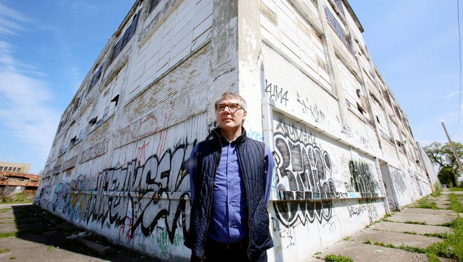 Robert Elmes of the Brooklyn  Galapagos Art Space, stands in front of his  building at 1800 18th Street in Detroit Tuesday, May 17, 2016 where this will become a place for artists to rent small studios.