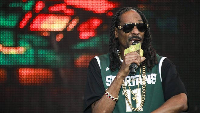 Snoop Dogg, shown here performing at Common Ground in July, will be in Flint on Saturday as part of the Hoop 4 Water event. The rapper partnered with former MSU basketball star Morris Peterson to create the charity event, with proceeds to benefit those affected by the Flint water crisis.