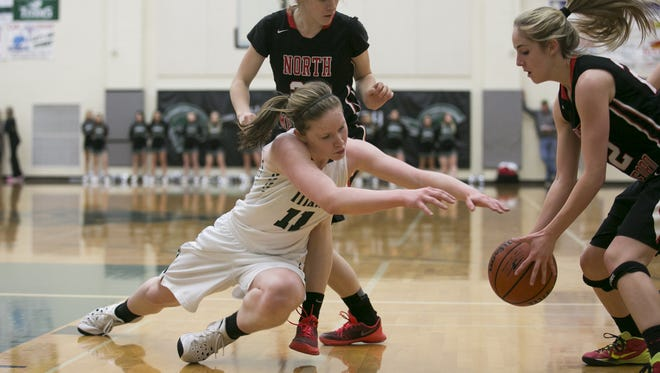 West Salem junior Delaney Henery (11) dives for a loose ball as it is picked up by North Medford in a game at West Salem High School on Tuesday, March 1, 2016. West Salem won the OSAA round one playoff game 58-55 in overtime.