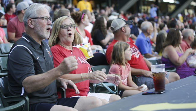 Kerry Smith and his wife, Rita Smith cheer for the Indianapolis Indians during the game against the Louisville Bats at Victory Field on July 5, 2016.