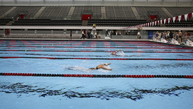 FILE – Swimmers practice in the newly renovated IUIPUI Natatorium on June 7, 2016. The venue hosted SwimFest last week.
