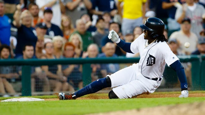 Detroit Tigers centerfielder Cameron Maybin slides into third against the Chicago White Sox on Aug. 2, 2016, at Comerica Park.