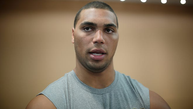 Michigan defensive lineman Chris Wormley speaks to reporters during media day event on Sunday.