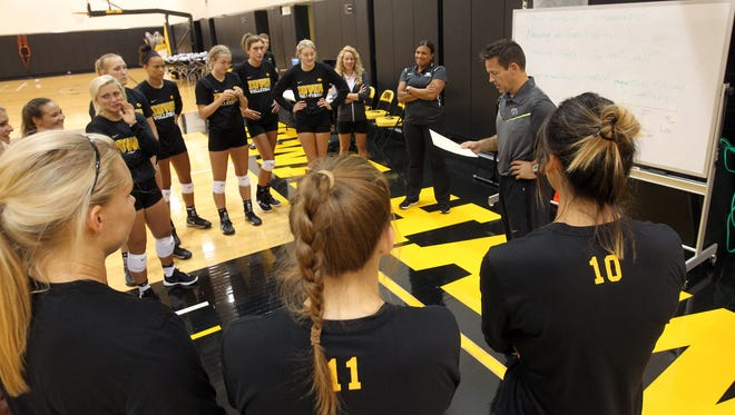 Iowa head coach Bond Shymansky talks with his team during practice at Carver-Hawkeye Arena on Friday, Aug. 19, 2016.