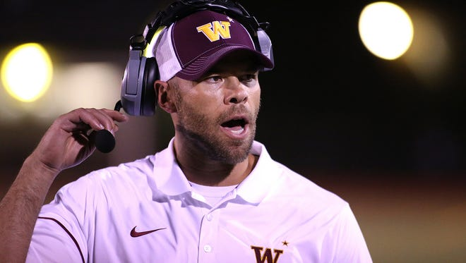 Windsor's new head coach Skylar Brower gives instructions to players on the sidelines during the Wizards'  33 to 21 win over Vista Ridge on Friday, September 2, 2016, in Windsor, Colo. (Photo by Brian Smith/For the Coloradoan)