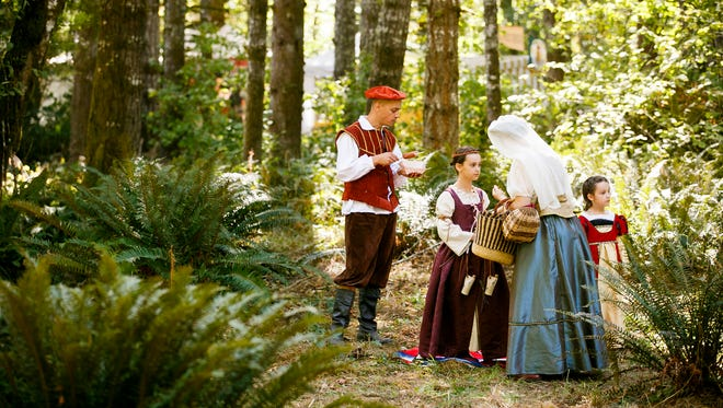 (Left to right) Michael, Miranda, Kate and Daphne Winder tidy up after a family picnic at the Shrewsbury Renaissance Faire on Sunday, Sept. 11, 2016, near Kings Valley. The Winders have been attending the fair for several years, wearing costumes handmade by Kate.