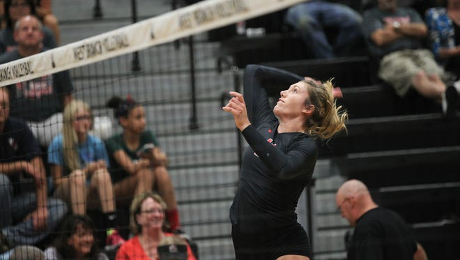 West Branch's Abby Knoop goes for a kill during the Bears' game against Mid-Prairie at West Branch on Tuesday, Sept. 20, 2016.