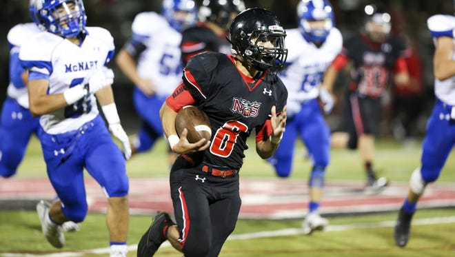 North Salem senior running back Alex Vasquez runs past McNary defense in the second half of the season opening-game on Friday, Sept. 2, 2016, at North Salem High School. McNary won the match-up 38-35.