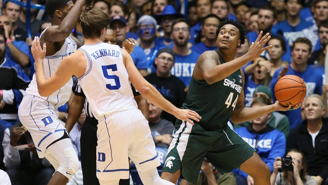Michigan State forward Nick Ward looks to pass the ball against Duke forward Amile Jefferson (21) and guard Luke Kennard (5) in the second half of MSU's 78-69 loss at Cameron Indoor Stadium on Tuesday, Nov 29, 2016.
