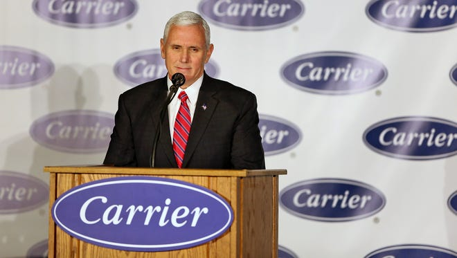 Vice President-elect Mike Pence is all smiles as he speaks at Carrier during an event at the Indianapolis factory announcing that jobs will stay in the US, Thursday, December 1, 2016.