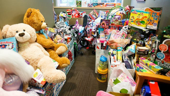 The Salem Health Medical Group collected more than 1,000 toys to donate to the Salem Police Department's annual toy drive. The department stopped by to pick up the donations with several vehicles, including the SWAT team's armored Lenco BEAR, on Wednesday, Dec. 14, 2016.