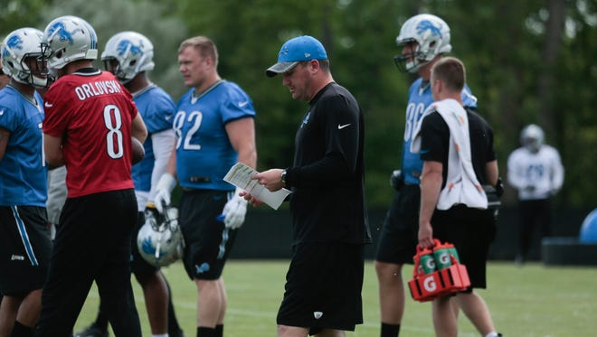 Detroit Lions offensive coordinator Jim Bob Cooter talks with players during practice in Allen Park on June 9, 2016.