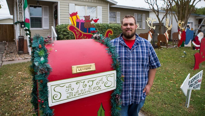 Nickolas Millikan stands next to his Stana's mailbox in his front yard at 1206 Belmeade Drive on Wednesday, Dec. 21, 2016.