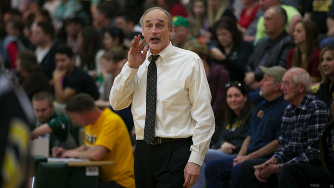 Cascade Coach Mark Stevens directs players against North Marion on Feb. 23, 2016.