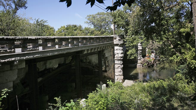 "Fall Creek is seen looking at the Central Ave. bridge, Tuesday, September 27, 2016.  Many changes are coming to the Fall Creek area, ""transforming Fall Creek into a recreational, residential, and commercial destination, with access to art, nature, and beauty, for every citizen, every day,""  says Doug Day, not pictured, an active neighborhood association member.  Several of the bridges in the area are crumbling and will be repaired."