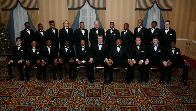 The 2015 Detroit Free Press All-State Football Dream Team and coach of the year pose for a photo Dec. 13, 2015, in Dearborn.