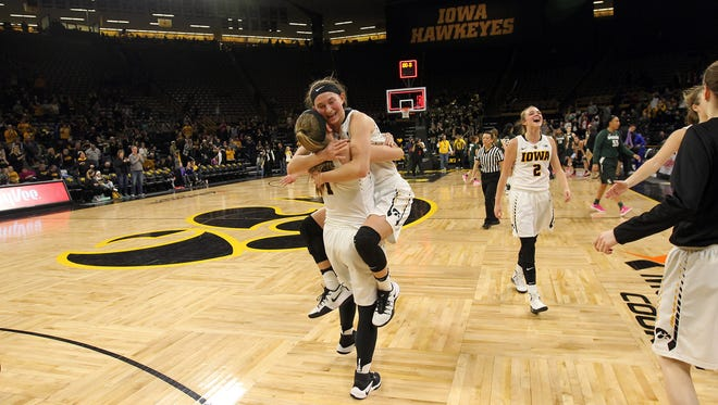 Iowa's Bre Cera gets a hug from Alexa Kastanek following their 87-83 overtime win over Michigan State at Carver-Hawkeye Arena on Thursday, Feb. 9, 2017.