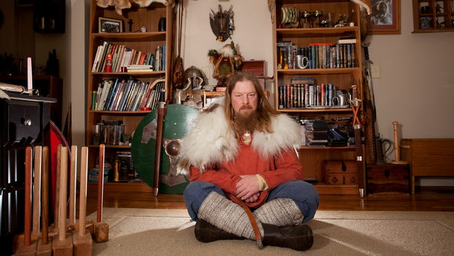 Tim McCumber poses for a portrait in one of his Viking reenactment costumes on Monday, Feb. 20, 2017 at his home in Charlotte.