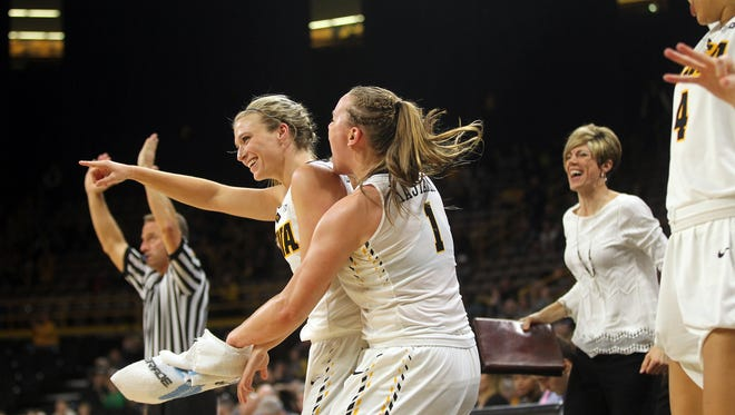 Iowa's Alexa Kastanek jumps off the bench to celebrate with Makenzie Meyer after a 3-pointer during the Hawkeyes' WNIT third round game against Colorado at Carver-Hawkeyes Arena on Thursday, March 23, 2017.