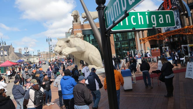 Fans hang out outside of Comerica Park in Detroit on Friday, April 7, 2017, before Opening Day for the Detroit Tigers.
