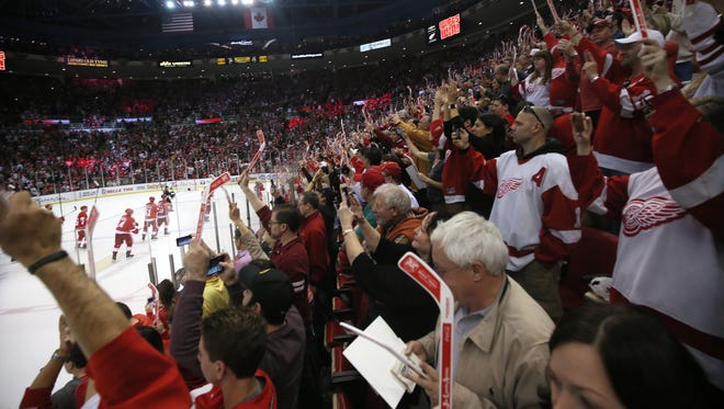 Red Wings fans cheer after the 4-1 win over the Devils on Sunday, April 9, 2017 in the final game at Joe Louis Arena.