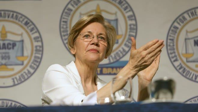U.S. Senator Elizabeth Warren cheers during the annual Freedom Fund dinner of the Detroit branch NAACP on Sunday, April, 23, 2017 at Cobo Center in Detroit.