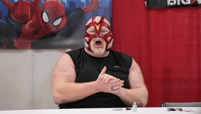 Wrestling star Big Van Vader waits for guests during the Motor City Comic Con in 2017.
