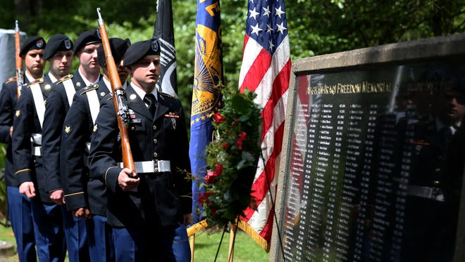 The Western Oregon University ROTC presents the colors during the Statewide Memorial Day Celebration organized by Oregon Department of Veterans' Affairs at the Afghan-Iraqi Freedom Memorial in Salem on Monday, May 29, 2017. The names of 142 Oregon service members who died in Afghanistan and Iraq are inscribed on the memorial wall.