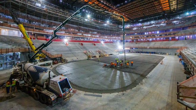 Cement is being poured at Little Caesars arena for the Red Wings ice rink on March 8, 2017.