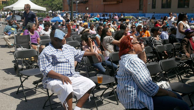 Festival goers watch a performance at the Madison Central stage during the Detroit Music Weekend on Saturday, June 10, 2017 in Detroit.