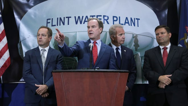 Attorney General Bill Schuette takes questions after announcing new charges against two high-ranking state health officials in the fourth round of criminal charges in the Flint drinking water crisis on Wed., June 14, 2017 during a press conference at Riverfront Banquet Center in downtown Flint.