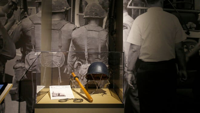 Large photographs and police riot gear from the 1960s are on display for the Detroit 67: Perspectives exhibit at the Detroit Historical Museum on Friday, June 16, 2017 in Detroit.