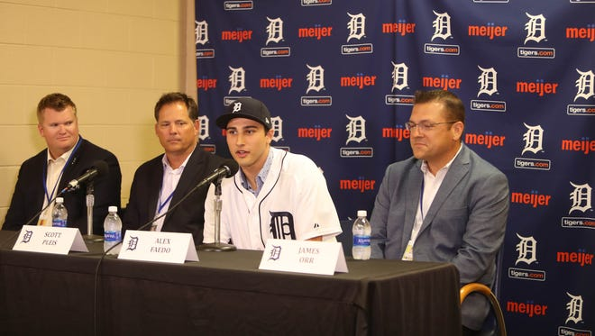 Left to right: Area scout RJ Burgess, director of amateur scouting Scott Pleis, Tigers first-round draft pick Alex Faedo and area scout James Orr take questions from reporters July 5, 2017 at Comerica Park.