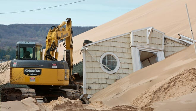 A home in the 1900 block of Shore Drive in Mears, Mich. is where one of two cottages on the property was swallowed by Silver Lake State Park sand dunes on April 28, 2017.