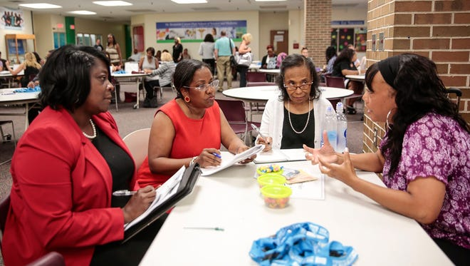 From left, Chrysler Elementary assistant principal Rhonda Ramsey, principal Wendy Shirley and ESPRO coach Joyce Hackett interview candidate Schelette Matthews of Southfield at the Dr. Benjamin Carson High School of Science and Medicine in Detroit, Thursday, August 17, 2017.