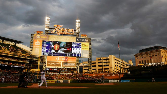 Aug 23, 2017; Detroit, MI, USA; Tigers designated hitter Victor Martinez hits a single in the second inning against the Yankees at Comerica Park.